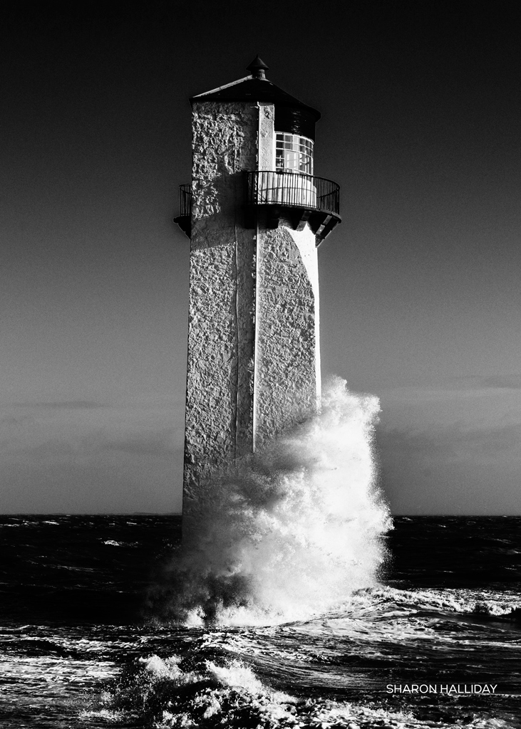 southerness lighthouse in a stormy solway